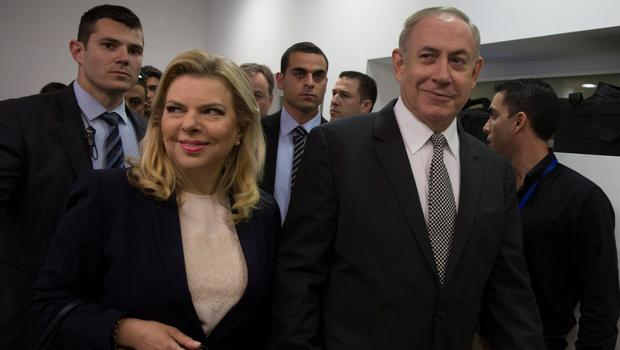 Israeli Prime Minister Benjamin Netanyahu and his wife Sara arrive at court