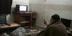 Video frame grab of Osama bin Laden watching himself on television in videos released by United States Pentagon
