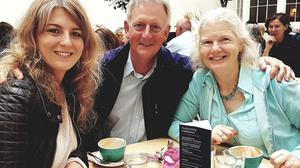 Aoife MacManus with her dad Ray and mum Jenny having coffee on one of her last visits home from Afghanistan