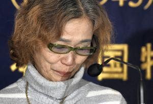 Junko Ishido, mother of Kenji Goto, one of two Japanese men being held by Islamist militants, reacts as she speaks during a press conference at the Foreign Correspondents' Club of Japan in Tokyo