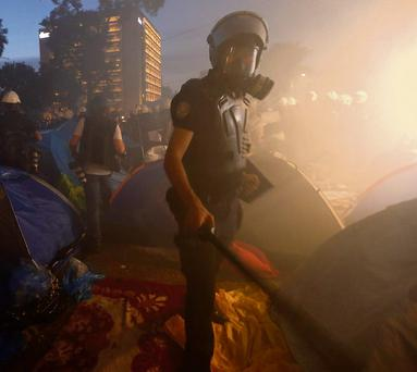 STRONG ARM OF LAW: Riot police in Gezi Park in Istanbul