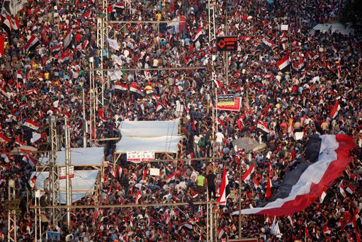 Protesters opposed to Egyptian president Mohamed Morsi in front of the presidential palace in Cairo