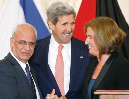 Chief Palestinian negotiator Saeb Erekat (left) with Israel's Justice Minister Tzipi Livni (right) and US Secretary of State John Kerry. Following last week's breakdown in talks in the region, John Kerry voiced impatience with all sides.