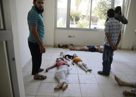 Children whom activists say were killed by gas attack in the Ghouta area of Damascus
