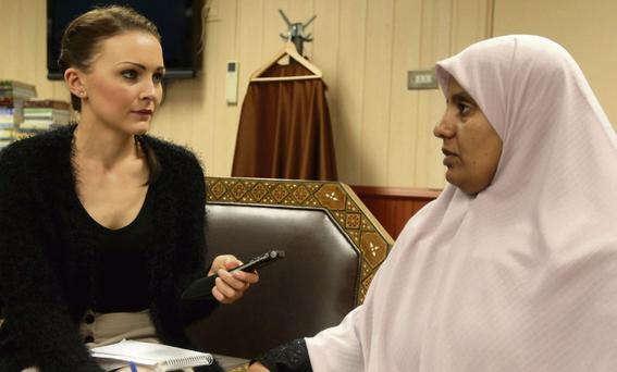 ANGUISH: Joanna Kiernan speaks to Nosayba Halawa inside the Clonskeagh Mosque.