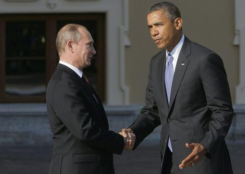 Russia's Vladimir Putin shakes hands with Barack Obama at the G20 Summit in St Petersburg