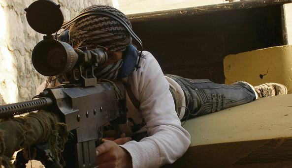 A rebel fighter of the Free Syrian Army in a village south of Aleppo