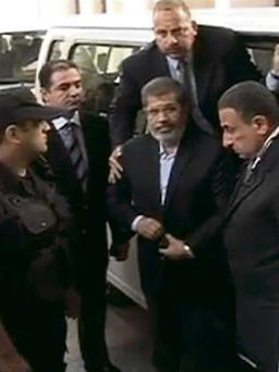 Egypt's ousted president, Mohammed Morsi, centre, arriving for his trial hearing in Cairo.