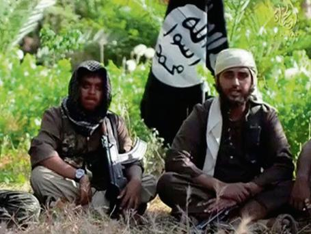 An Islamist fighter, identified as Abu Muthanna al-Yemeni from Britain (R), speaks in this still image taken from an undated video.