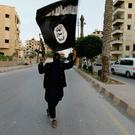 A member of ISIL is pictured in Raqqa (REUTERS)
