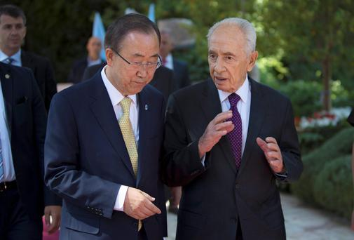 UN Secretary-General Ban Ki-moon speaking with former Israeli President Shimon Peres, right, last week