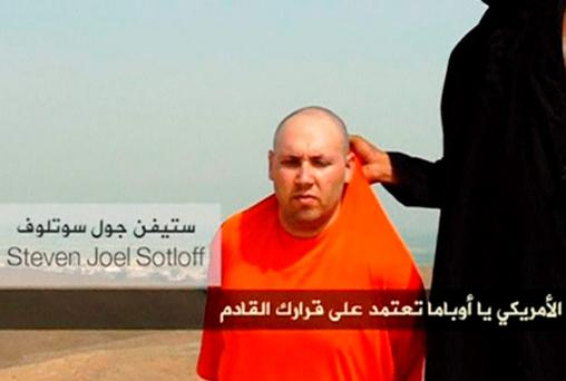 Still image from undated video of a masked Islamic State militant U.S. journalist Steven Sotloff who has reportedly been beheaded.