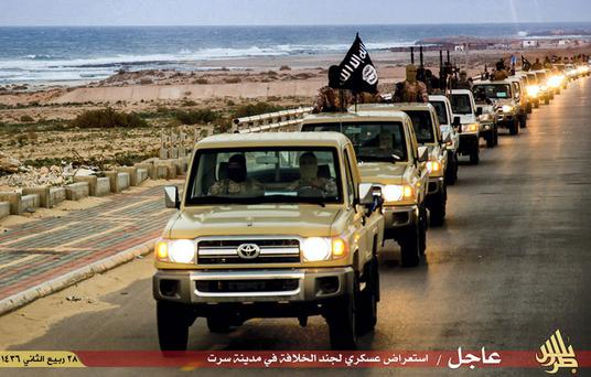 An Isil military convoy drives through Libya in this picture released by the terror group.