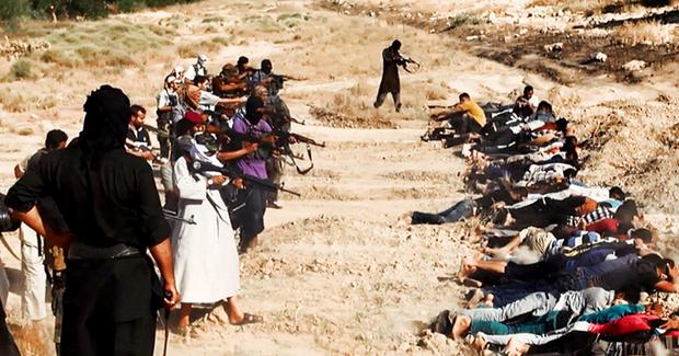 Isil militants prepare to execute captured Iraqi soldiers held prisoner near Tikrit last year. Today the Iraqi army is pressing the terrorist group to regain possession of Saddam Hussein's home town
