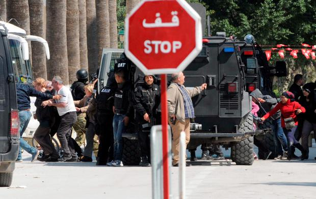Visitors and tourists run for cover at the Bardo museum in Tunis as gunmen open fire.
