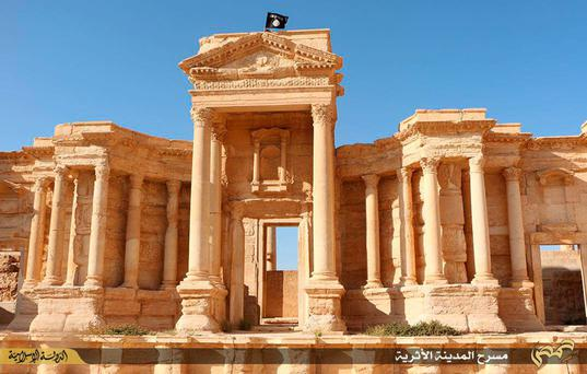 An Isil flag flies above the 2,000-year-old city of Palmyra – a Unesco world heritage site 215km from Damascus, Syria