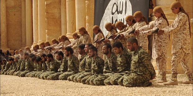 Young Isil recruits prepare to execute a row of soldiers in this image from a video released by the terror group