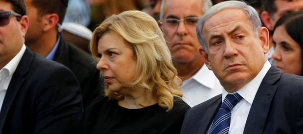 Israel's Prime Minister Benjamin Netanyahu centre, and his wife Sara sit next to President Reuven Rivlin (right) during a ceremony on Mount Herzl in Jerusalem commemorating soldiers who died in the 2014 Gaza war a year ago this week.