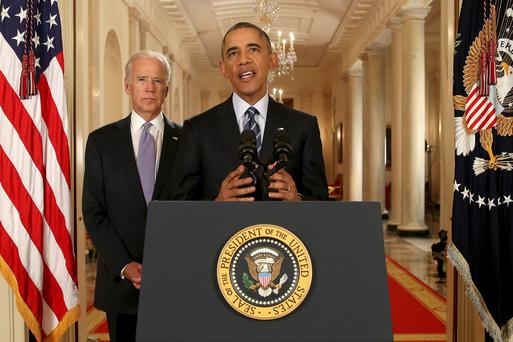 President Barack Obama, standing with Vice President Joe Biden, conducts a press conference in the East Room of the White House in response to the Iran nuclear deal