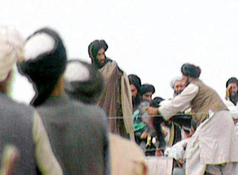 A screen grab taken from BBC footage shot in Kandahar in 1996 which purportedly showed the Afghan Taliban's leader Mullah Muhammad Omar (centre).