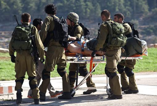 A wounded soldier is taken to hospital in Jerusalem yesterday.
