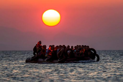 Migrants on a dinghy arrive at the southeastern island of Kos, Greece, after crossing from Turkey. Greece has become the main gateway to Europe for tens of thousands of refugees and economic migrants, mainly Syrians fleeing the war in their country, as fighting in Libya has made the alternative route from north Africa to Italy increasingly dangerous.