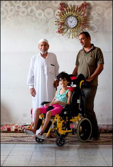 SHATTERED LIVES: Eight-year-old Maha Sheik Khalil was paralysed after heavy shelling of her neighbourhood of Shejaiya in East Gaza. Her father and granddad care for her, as her mother was killed