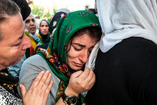 Relatives cry as they mourn during the funeral yesterday for a victim of Saturday's Ankara bomb attacks in Istanbul, Turkey. Photo: Burak Kara/Getty Images