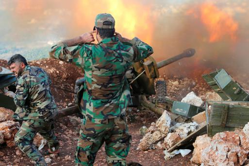 Syrian soldiers fight near the border with Turkey
