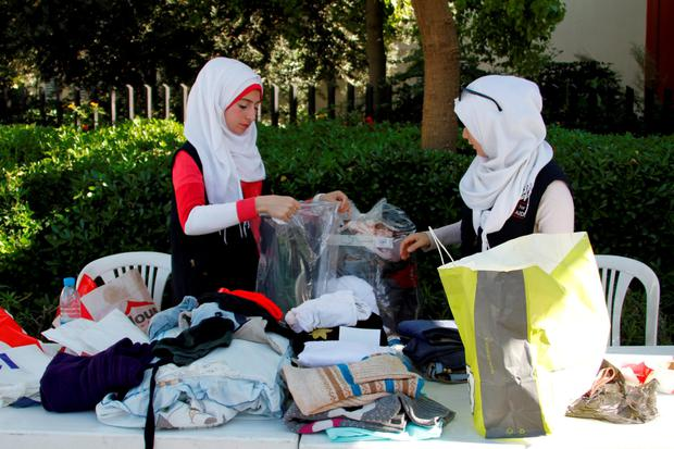 Volunteers gather winter clothes to be distributed for Syrian refugees in northern Lebanon