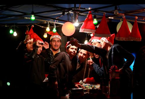 Youths take a selfie during celebrations ahead of the birthday of Prophet Mohammed in Benghazi, Libya, this week