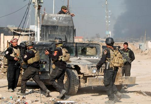 Members of Iraq's elite counter-terrorism service gather on December 29, 2015 in the city of Ramadi, the capital of Iraq's Anbar province, about 110 kilometers west of Baghdad, after Iraqi forces recaptured it from the Islamic State (IS) jihadist group. Iraq declared the city of Ramadi liberated from the Islamic Stat