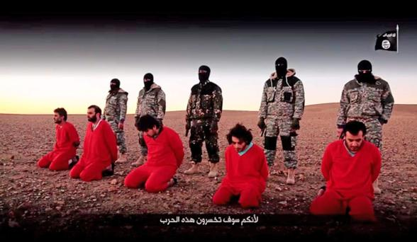 A screen grab taken from undated footage issued by Isil militants shows the murder of men accused of being spies for the UK. Photo: PA