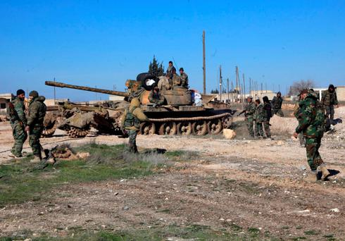 Syrian pro-government troops hold positions in the Syrian town of Ain al-Hanash near l-Bab in Aleppo's eastern countryside earlier this week as regime forces have recaptured the area from Islamist jihadists. Photo: AFP/Getty Images