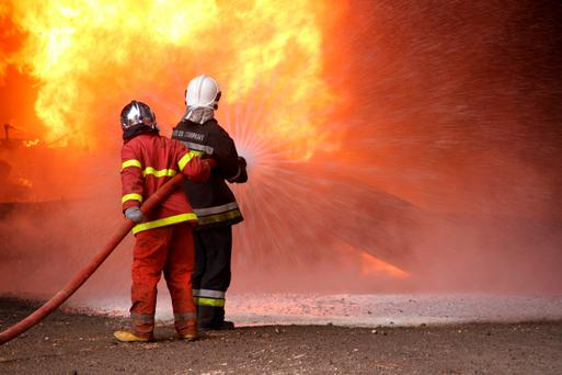 Firefighters try to put out the fire in an oil tank in the port of Es Sider, in Ras Lanuf, Libya last month. Isil have been setting fire to Libya's oil terminals in attacks