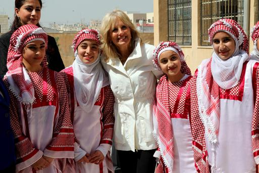 Students pose with Jill Biden (C), wife of U.S. Vice President Joe Biden, during her visit to their school that has Syrian refugee students enrolled in the Jordanian city of Mafraq,