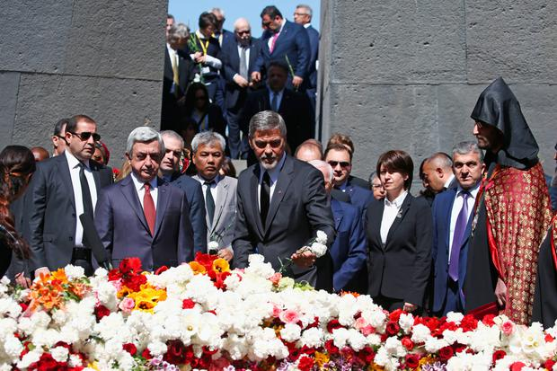 Actor George Clooney attends the laying of the flowers at a genocide memorial in Yerevan. Photo: Getty Images