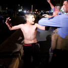 Iraqi security forces detain a boy after removing a suicide vest from him in Kirkuk, Iraq. Photo: Reuters