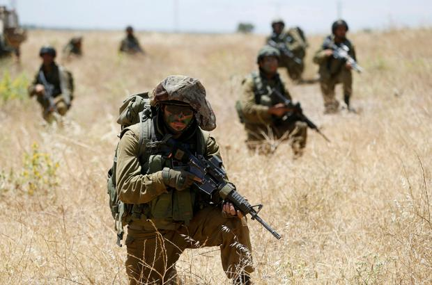 Israeli soldiers take part in a training session on the Israeli border with Syria and the Golan Heights. Photo: Baz Ratner