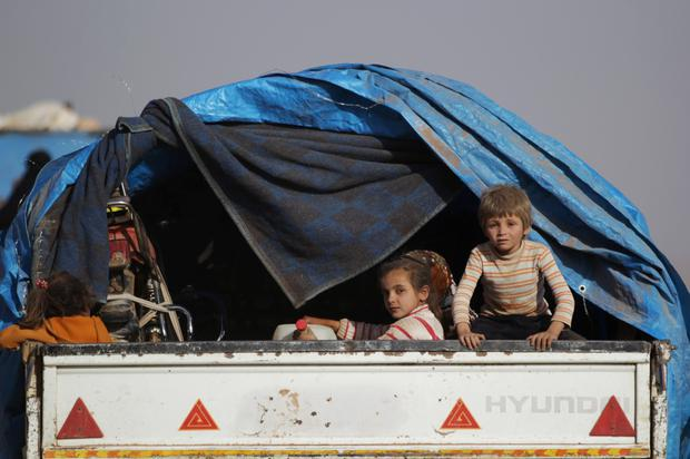 Children who fled from Islamic State-controlled areas ride a pick-up truck to the northern Syrian rebel-held town of al-Rai, in Aleppo Governorate, Syria.