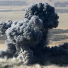 Smoke rises from Isil positions in the town of Naweran, near Mosul Photo: Reuters