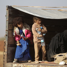 Iraqi refugees who fled violence in Mosul, Iraq, ride a pick-up truck upon arrival in al-Kherbeh village, northern Aleppo province, Syria Photo: Khalil Ashawi/Reuters