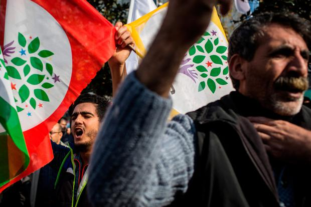 Supporters of the pro-Kurdish People's Democratic Party (HDP) chant slogans during a rally in Istanbul