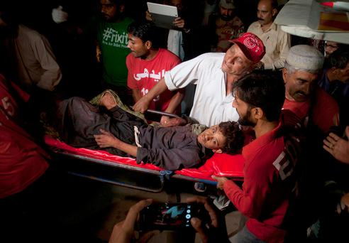 Pakistani police say a bomb blast at a Sufi shrine has killed several people and wounded many others in the country's southwest. Photo: AP Photo/Shakil Adil