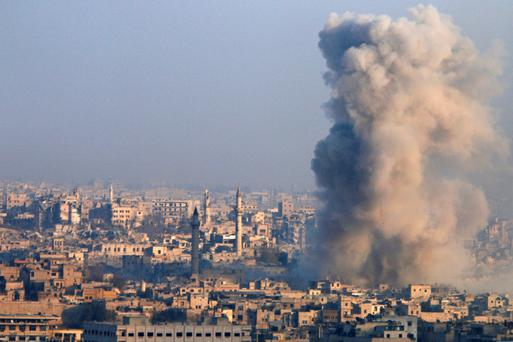 Smoke from an explosion rises in Aleppo. Photo: Reuters