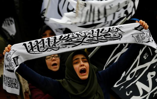 Demonstrators shout slogans during a demonstration to show solidarity with the citizens of Aleppo, Syria, after Friday prayers in front of the Kocatepe Mosque in Ankara, Turkey.
