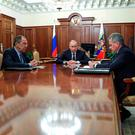 Russian President Vladimir Putin, center, and Foreign Minister Sergey Lavrov, left, listen to Defence Minister Sergei Shoigu in Moscow, Russia on Thursday. Photo: Mikhail Klimentyev/Sputnik, Kremlin Pool Photo via AP