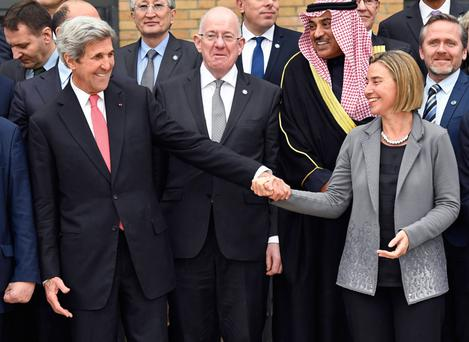 US Secretary of State John Kerry holds hands with EU foreign policy chief Federica Mogherini as Irish Foreign Minister Charlie Flanagan looks on during the Middle East peace conference in Paris. Photo: Reuters