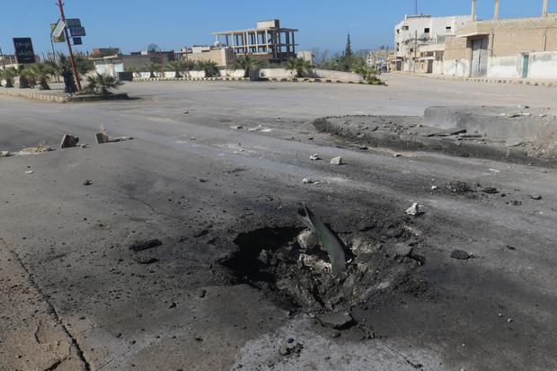 A crater is seen at the site of an airstrike, after what rescue workers described as a suspected gas attack in the town of Khan Sheikhoun in rebel-held Idlib, Syria. Photo: Reuters