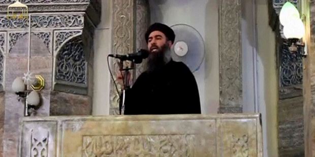 The reclusive leader of Isil, Abu Bakr al-Baghdadi, making his only public appearance, at a mosque in the centre of Mosul in 2014. Photo: Reuters